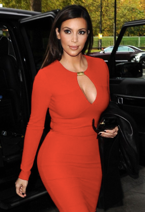 Kym Kardashian in a figure-hugging dress